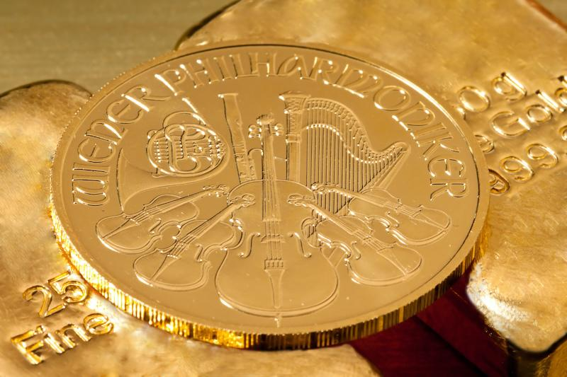 Philharmonic Coin placed on top of gold bars