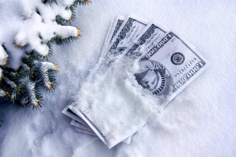 Money placed on snow