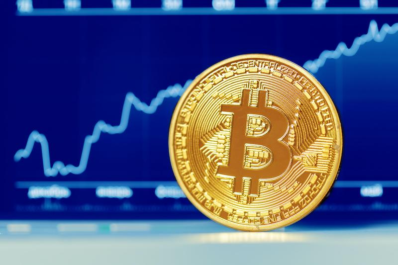 Bitcoin with graphs in background