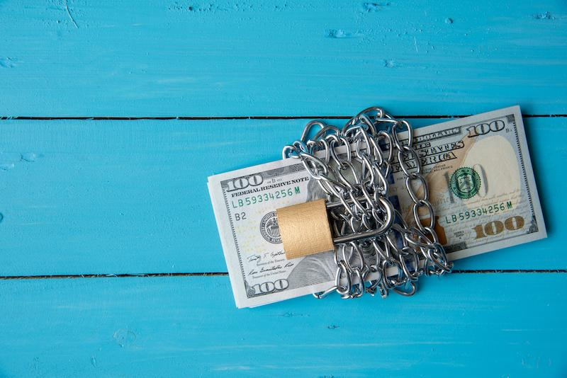 US Dollar tied with chains and locked