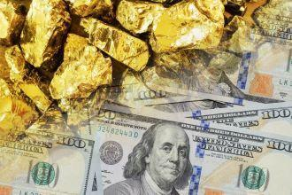 Image of large gold nuggets mixed with American paper money