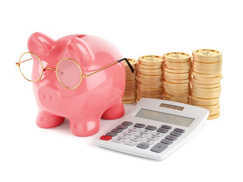 Piggy bank with calculater and coins stack