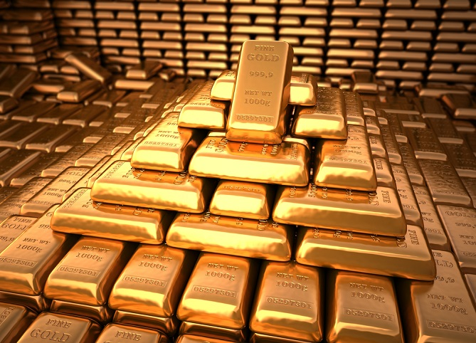 Rows of neatly stacked gold bars in the shape of a pyramid