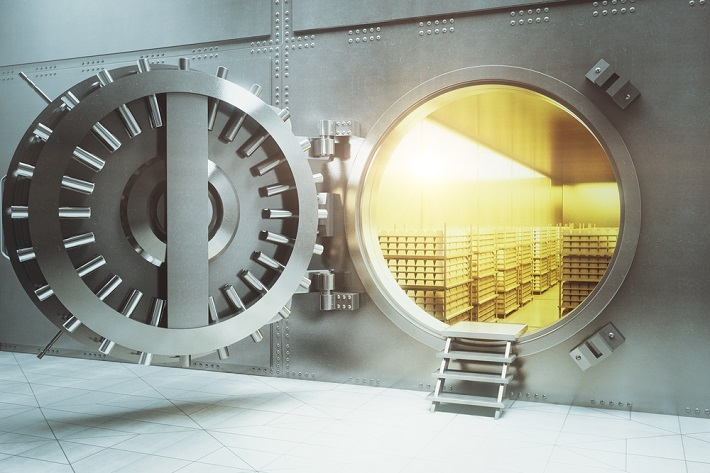Image of a vault with door wide open showing gold stacks inside