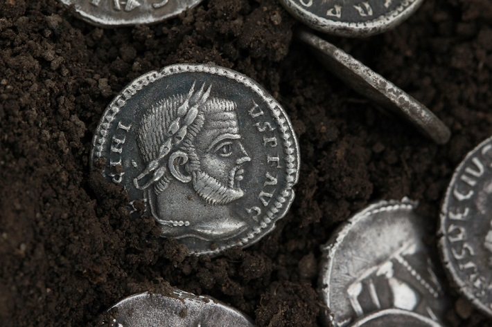 Silver coins lying in something black