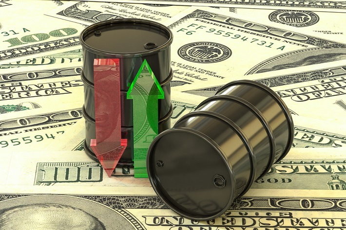 Image of oil barrels sitting on top of paper money.
