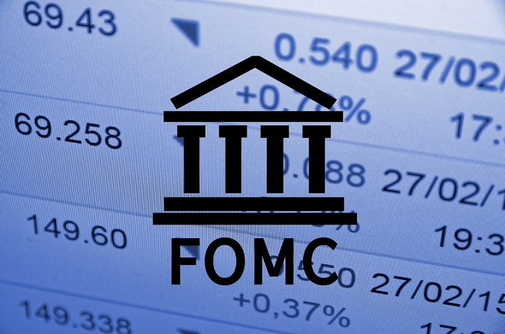 FOMC - Federal Open Market Committee logo with some statistics in the background