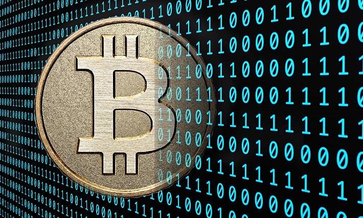 Image of a Bitcoin fading into binary code