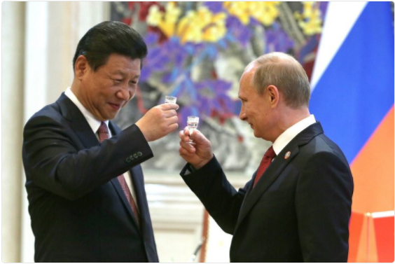 Image of Russian President Putin and Chinese President Jinping toasting with a shot of vodka