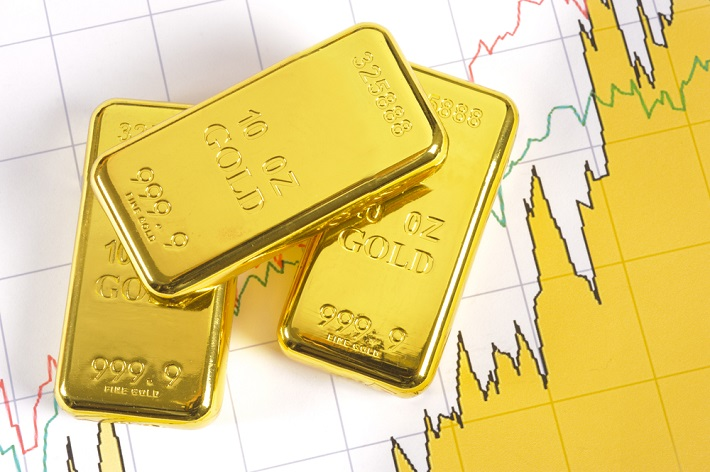 Abstract image of three gold bars with multiple upward trending graphs