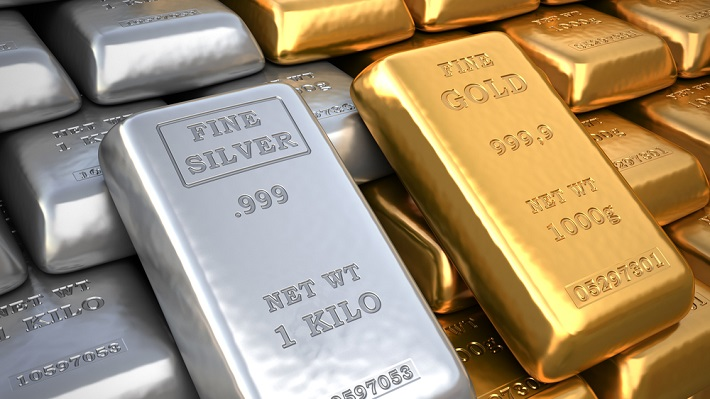 Neatly stacked rows of gold and silver bullion side by side.