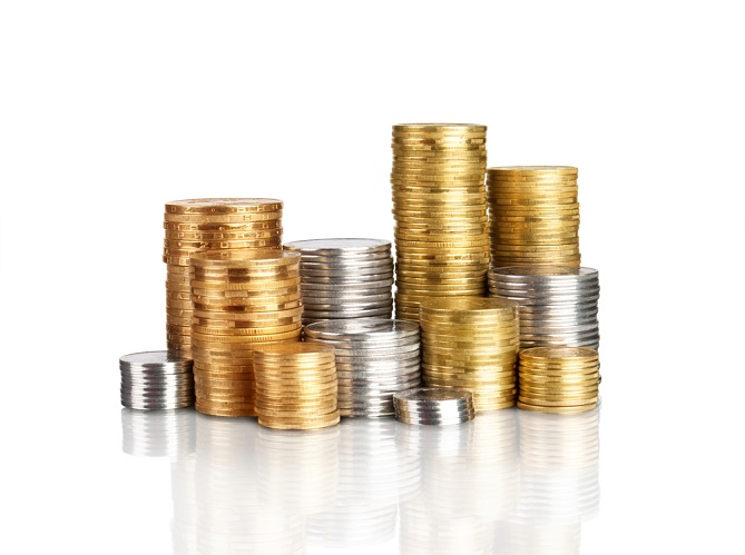 Multiple gold and silver coins stacks of varying heights