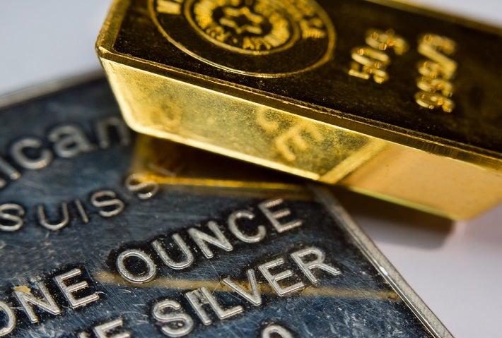 A 50g gold bar and 1 oz silver bar