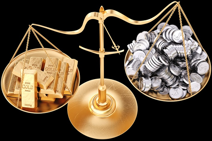 Image of a balanced scale with gold bars on one side and silver coins on the other