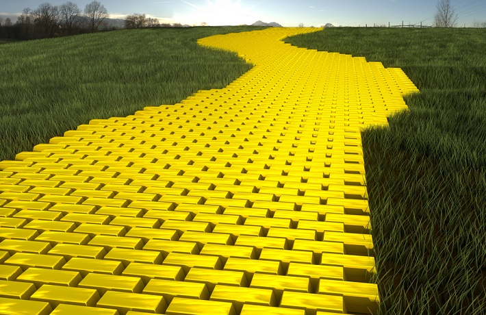 A path of gold bars with grass on both sides