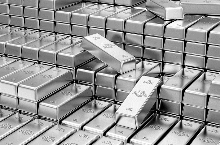 Image shows multiple stacks of silver bars