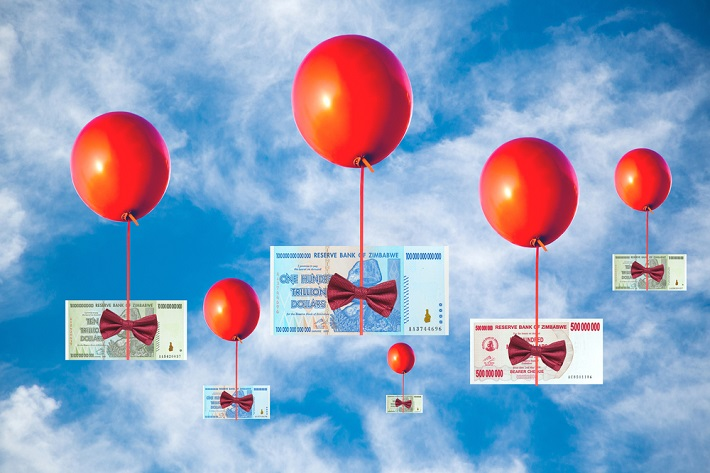 Red balloons holding paper money with their strings and moving up to the sky