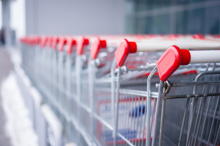 Close up view of a row of shopping carts that continues off into the horizon