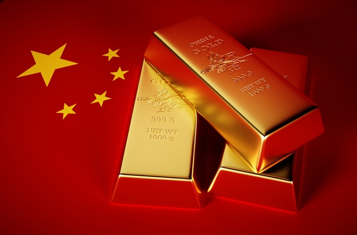 Image of gold bars sitting in a Chinese flag