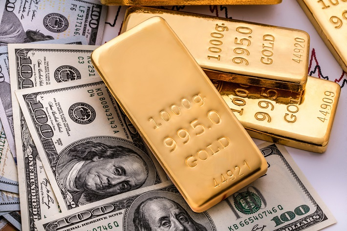 Image: gold bars and dolar bills